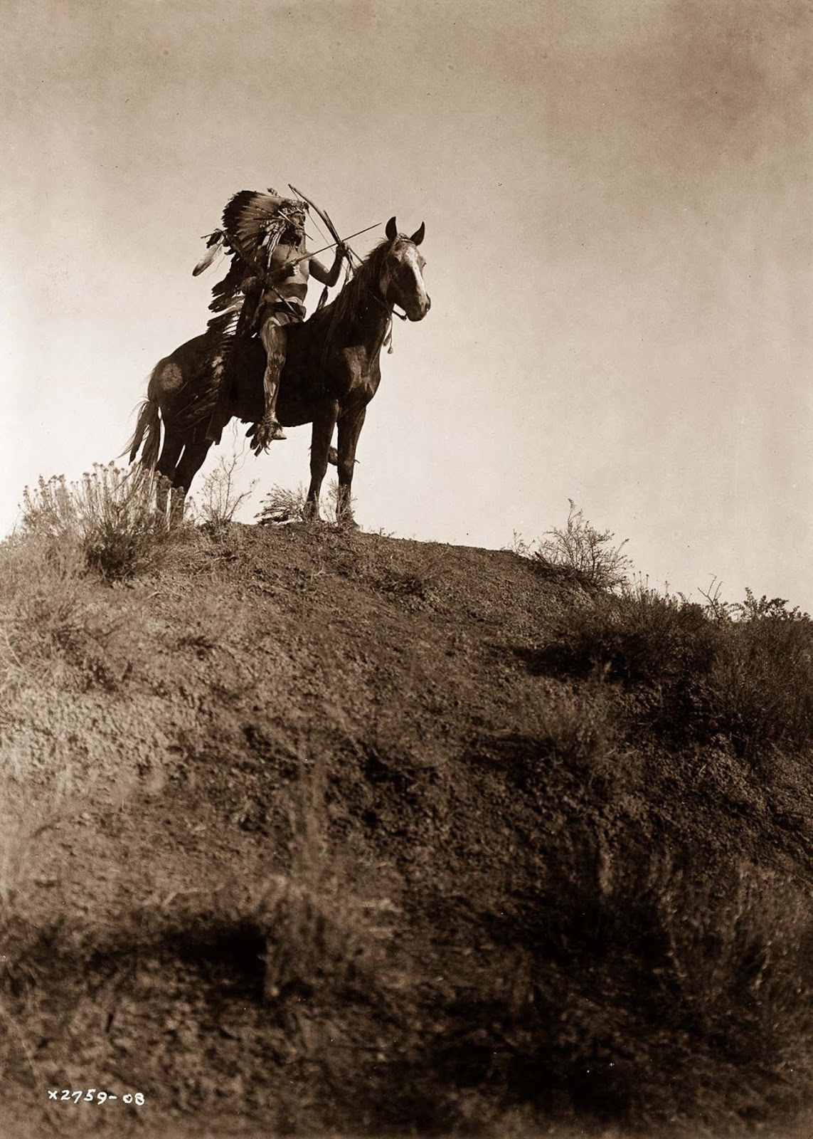 An Apsaroke man on horseback. 1908.
