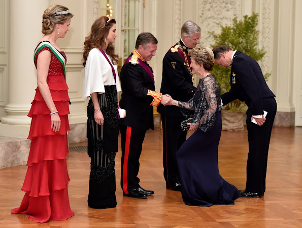 Queen Mathilde and Queen Rania attends a gala dinner at the Laeken royal Palace in Brussels. Queen Rania wore Valentino Gown, Queen Mathilde wore red gown. Queen Mathilde wore diamondTiara, Queen Rania diamond tiara