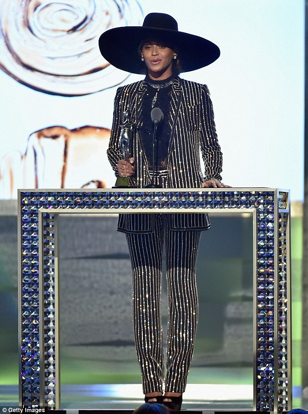 Beyonce sparkles in a Givenchy suit at the CFDA Fashion Awards
