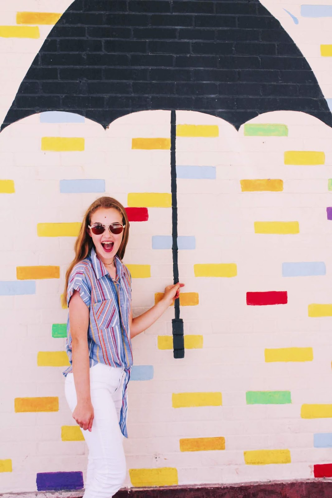 Galveston Travel Guide // The Strand Galveston umbrella mural striped top