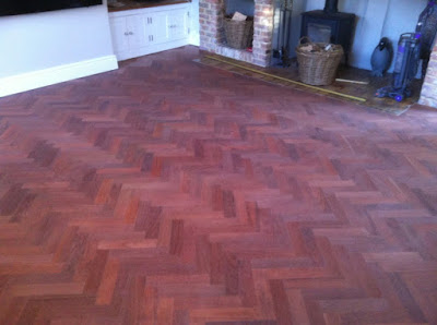 Blood red parquet floor after sanding