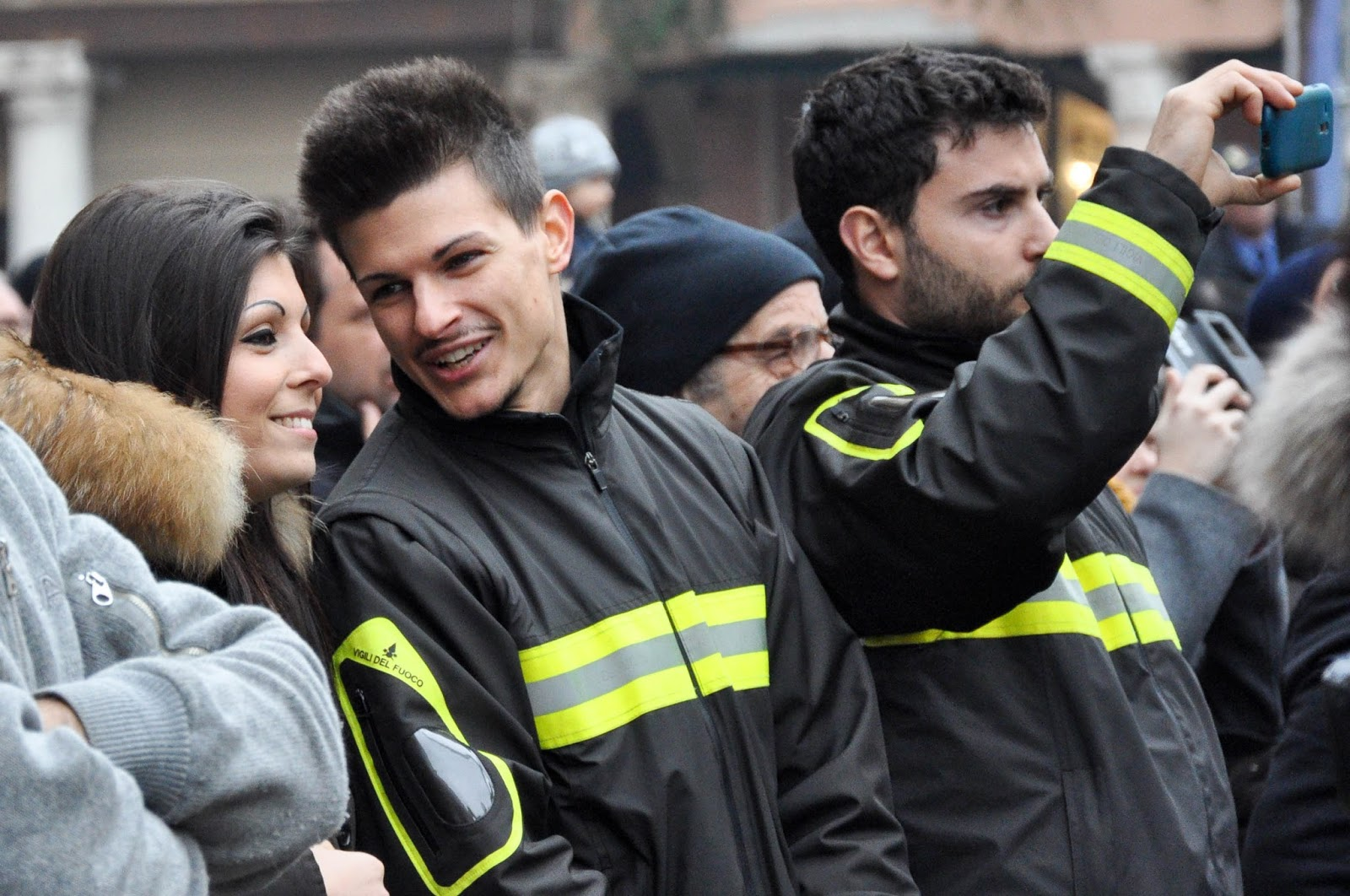 Firefighters watching their colleagues' demonstration on Piazza dei Signori, Saint Barbara celebration, Vicenza, Veneto, Italy