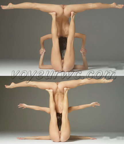 Two sexy twin sisters performing nude gymnastic exercises together and posing naked