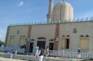 Egypt mosque attack: Hundreds killed in bomb and gun assault