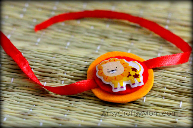 Cute Lion Sticker rakhi for kids to make . We have 15 best ideas to make Rakhi at home for Rakshabandhan - Perfect rakhi ideas for kids to make, rakhi competition, best of waste, simple and handmade with detailed step by step images- ArtsyCraftsyMom