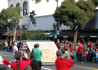 Airborne BMX rider executing a twist above the Jiffy Market ramp, S. Santa Cruz Avenue, Los Gatos, California