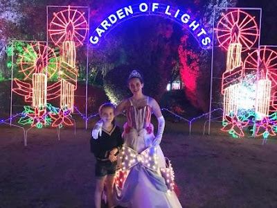 "Girl posing with Princess at ""Garden of Lights"""