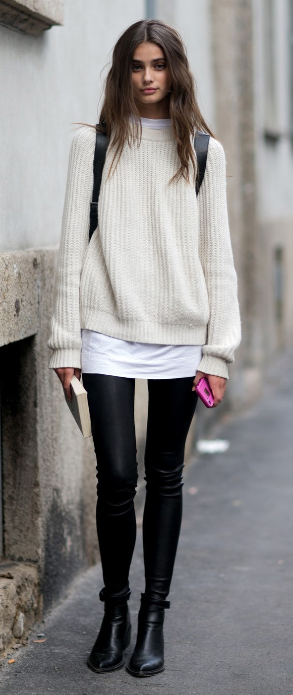trendy fall outfit / white sweater + top + black leggings + boots
