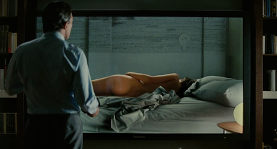 The Skin I Live In 2011 film Pedro Almoldovar screenshot antonio banderas robert ledgard vera watching screen