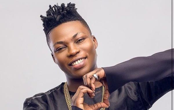 Singer Reekado Banks shows off his pet cat