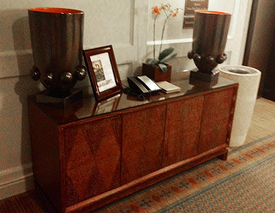 Large Cabinet with Urns and Telephone