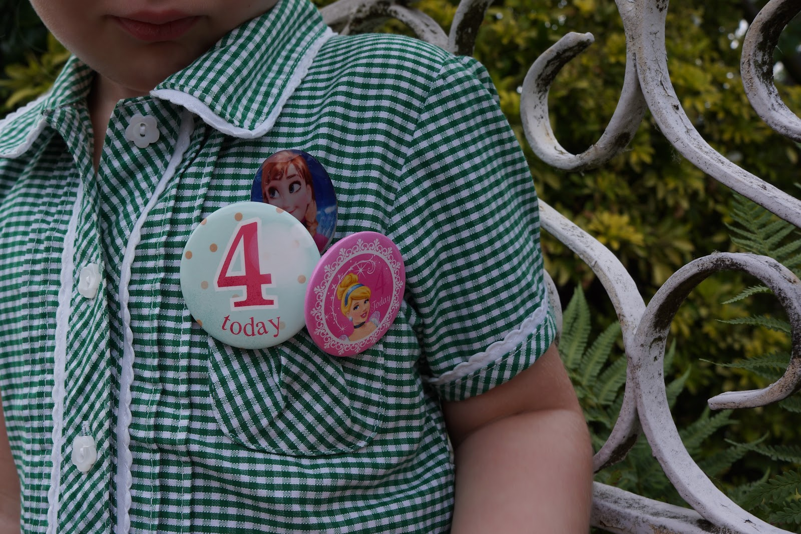 three princess badges with number four on them