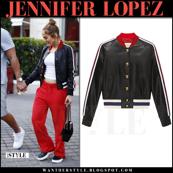 Jennifer Lopez in black leather bomber jacket gucci and red pants what she wore june 18 2017