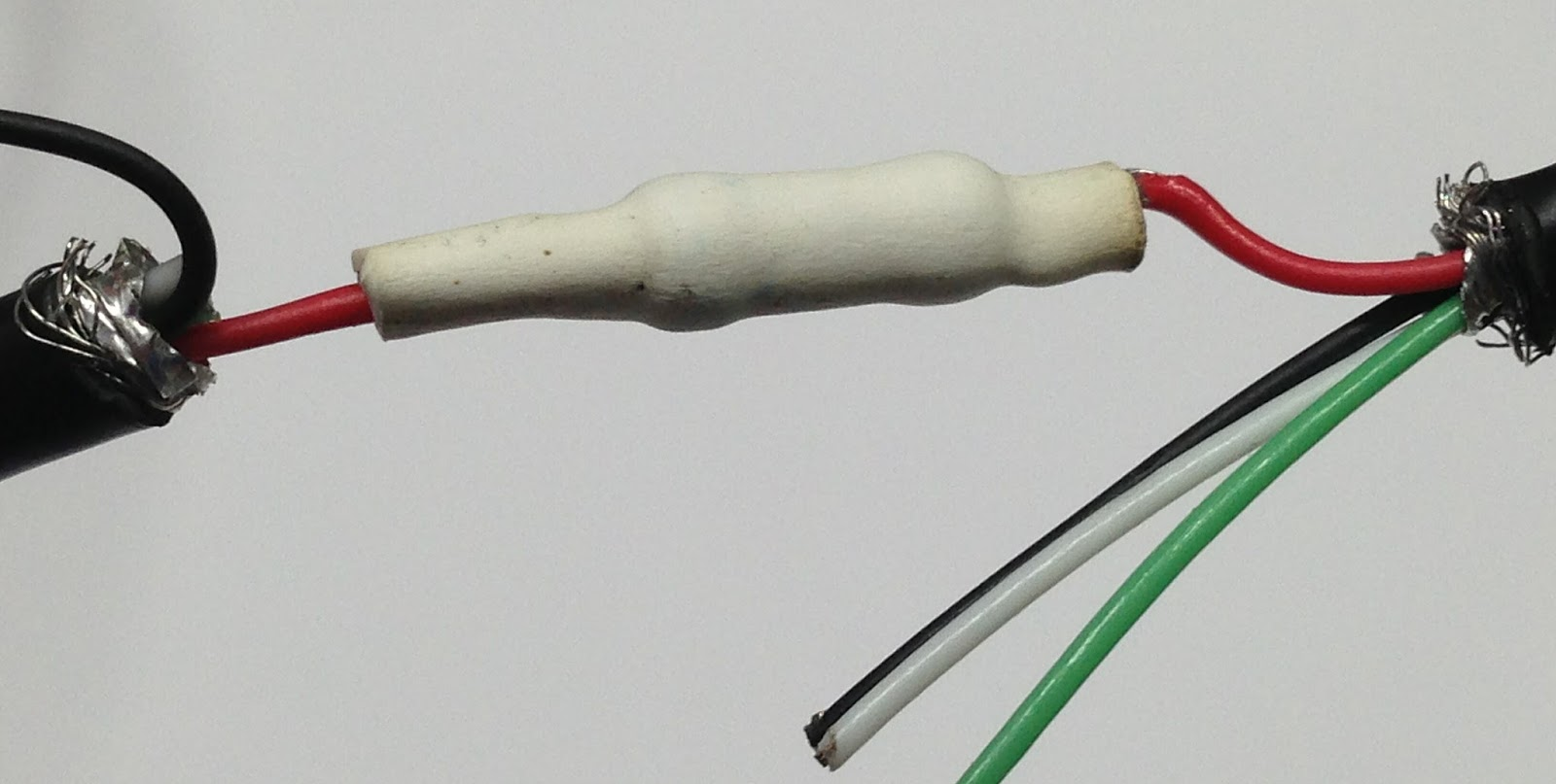 Next, fold the cable back on itself and tape or zip-tie the cable together.  The tape or zip-tie acts as a strain-relief to prevent stress on the solder  ...