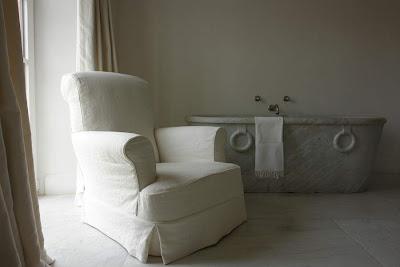 "Garnier's bathing room, marble tub, ""Chateau"" custom chair available at Garnier Interiors image via Garnier (be) website, as seen on linenandlavender.net"