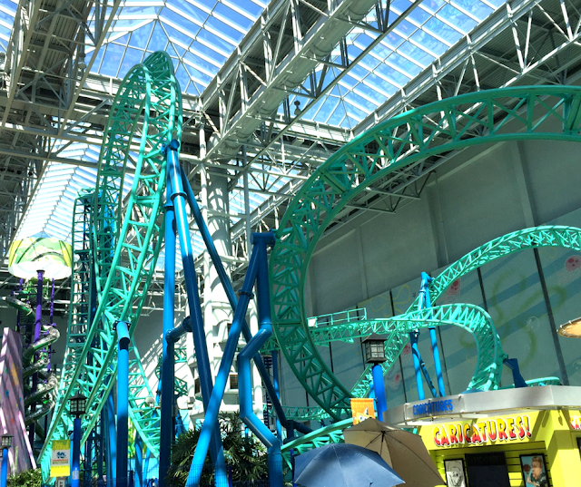 Blue roller coaster threaded throughout Nickelodeon Universe
