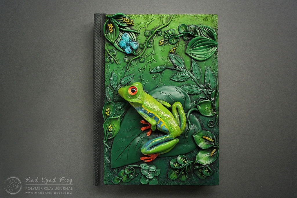11-Green-Frog-Aniko-Kolesnikova-Polymer-Clay-Book-Diary-and-Electronics-Cover-www-designstack-co