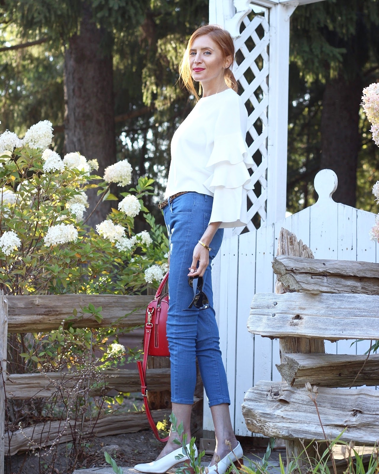 White tiered statement sleeve sweater, blue denim, leopard belt, red bag, paris inspired, White mules