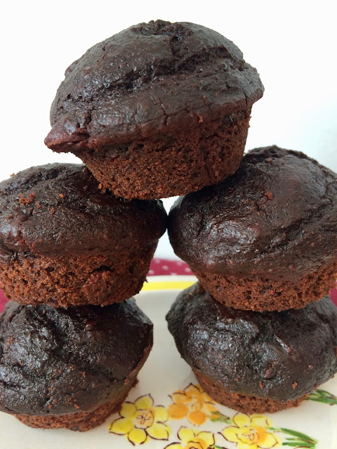 Stacked chocolate beet mini muffins.