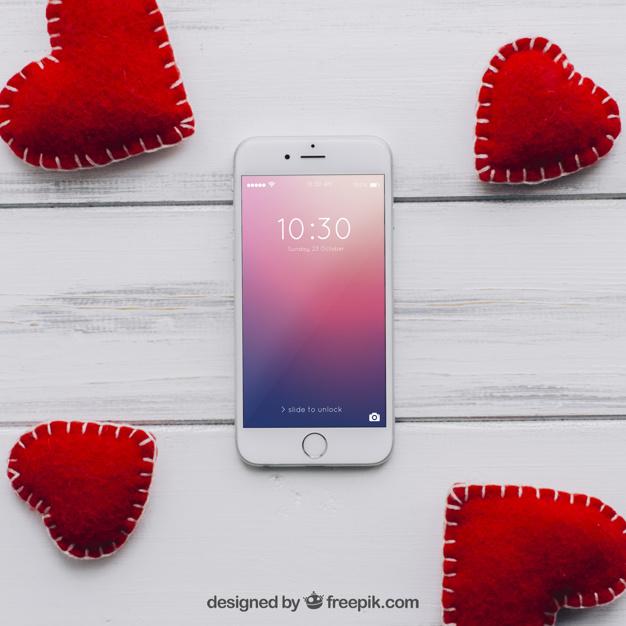 Valentine elements and smartphone mockup Free Psd