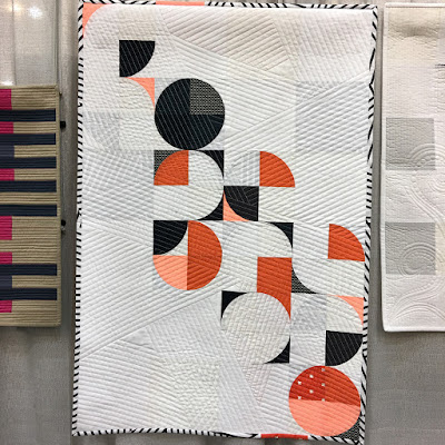 Luna Lovequilts - Orange Pop hanging at Quiltcon 2018