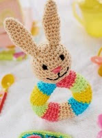 http://www.letsknit.co.uk/free-knitting-patterns/bunny-rattle