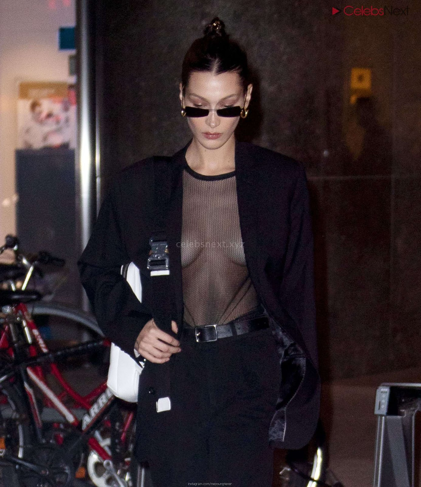 Bella Hadid boobs exposed in transparent  T shirt Bra kess boobs CEleBrityBooty.co Exclusive