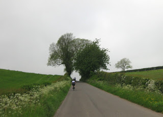 Cycling along a rural road outside Dumfries, Scotland