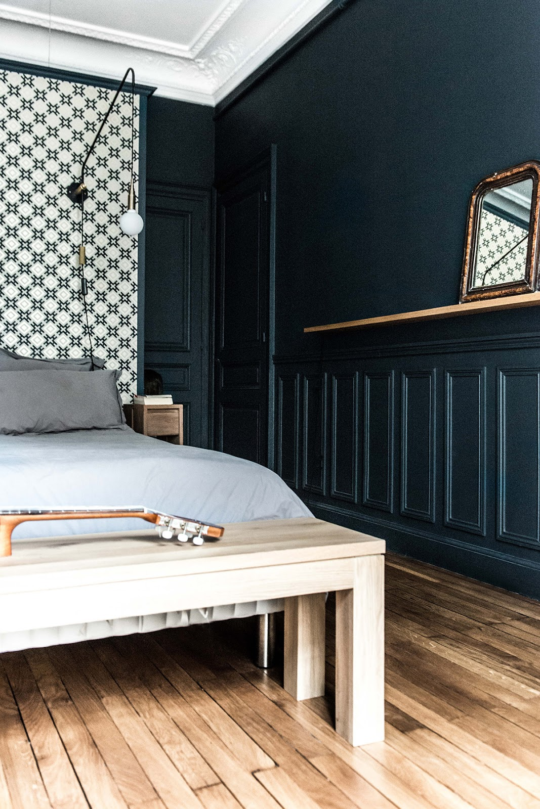 pattern bed headboard, bedroom with wood paneling