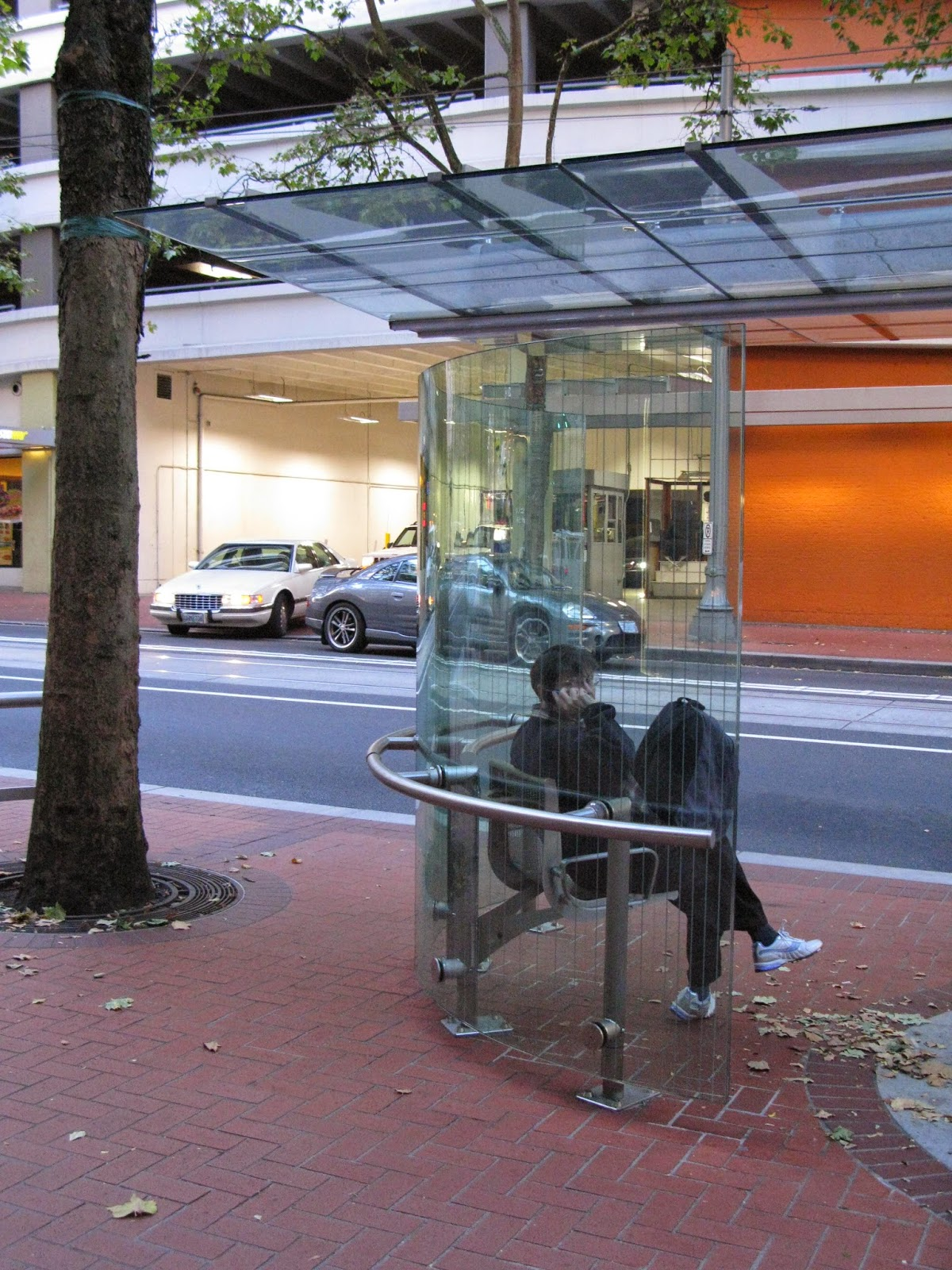 Urban bus shelter with windscreen and seating, Portland OR