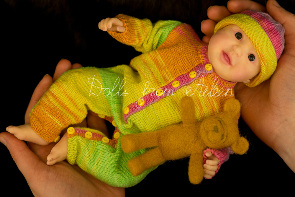 hands holding ooak posable baby doll