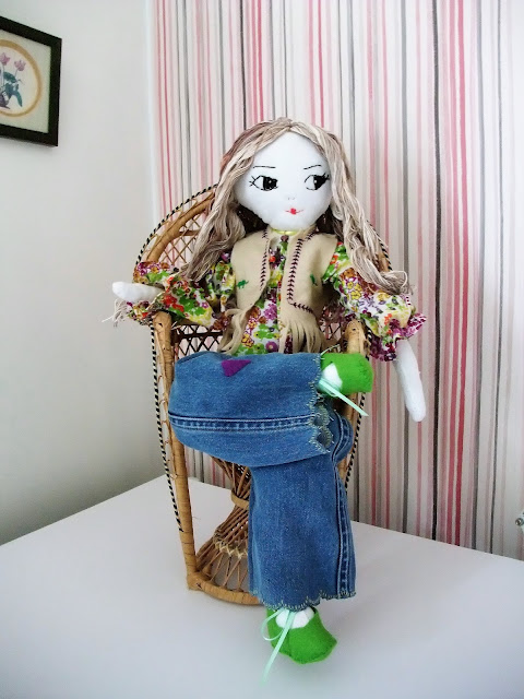 70s style rag doll in peacock chair by karen vallerius