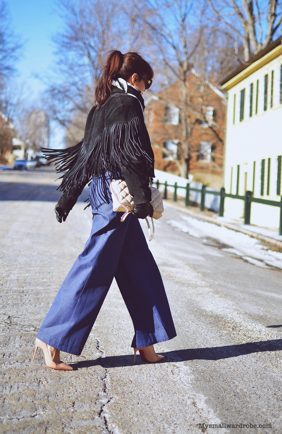 Outfit with wide leg pants and fringe jacket