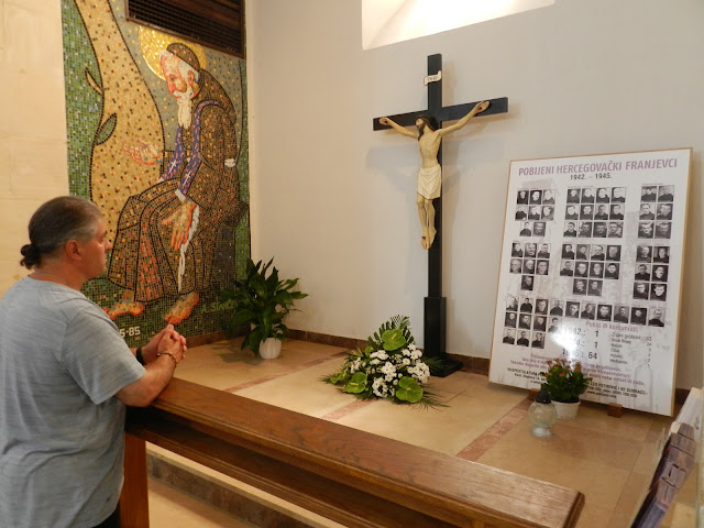 A photo of me honouring the Franciscan friars within the church