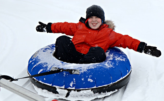 A ride in a snowy inner tube