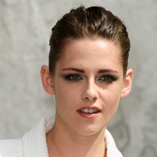 Kristen Stewart goes topless for perfume ad - photos and video
