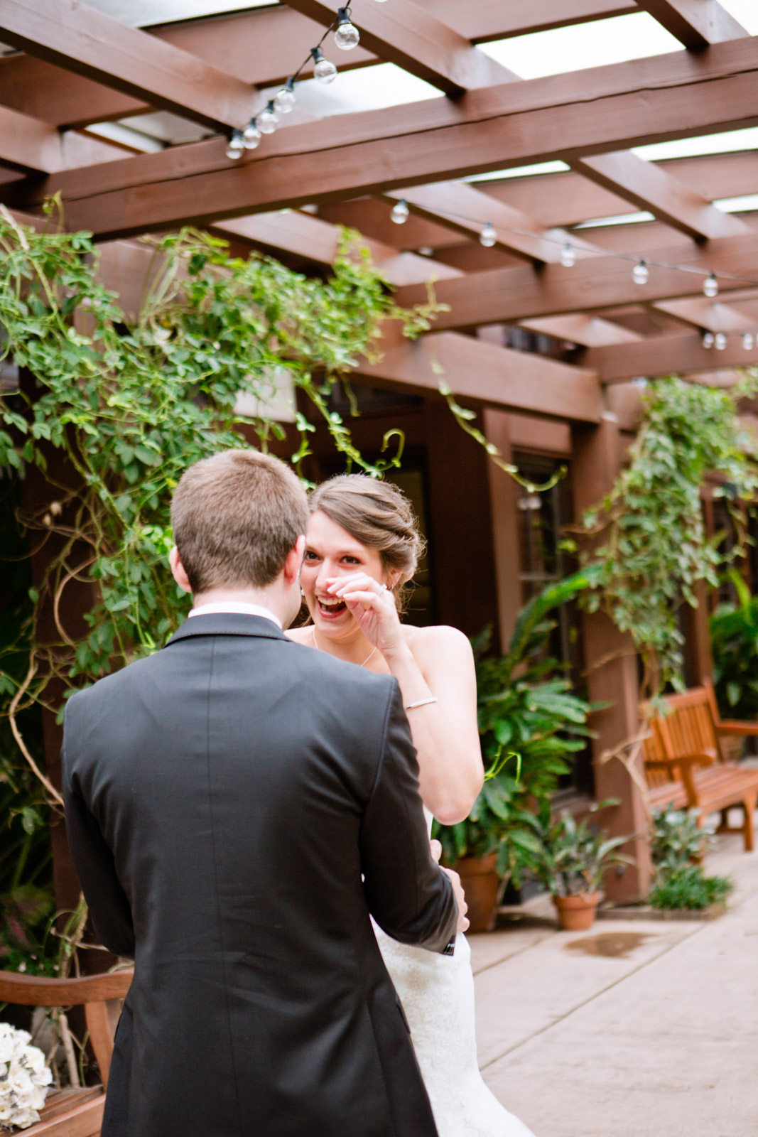 a bride cries in gratitude seeing her groom cry too