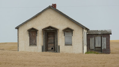 house, abandoned, Fox Valley, Saskatchewan, stucco