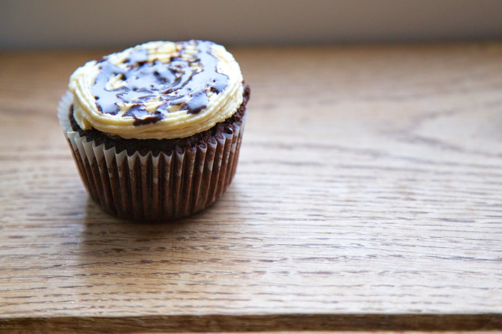 Chocolate cupcake with baileys frosting and chocolate sauce