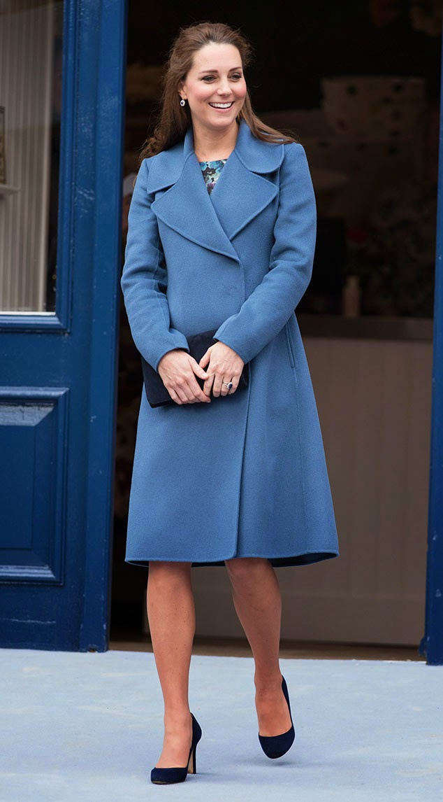 Kate Middleton shows off baby bump in a blue coat and floral dress at the Emma Bridgewater Factory in Trent