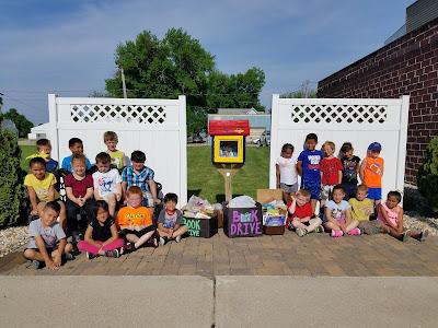 CAL Kindergarten donates books to Latimer Little Free Library
