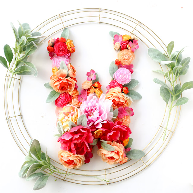 Craft a DIY Floral Monogram Wreath for Spring or Summer using gold spray paint and faux flowers from the craft store
