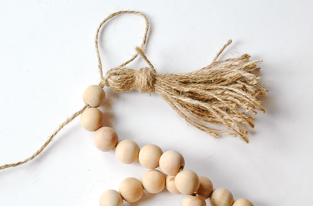 Adding tassel to jute bead garland
