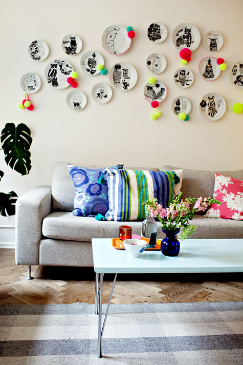 The Artful Plates add Whimsy and Bold Flair in this Living Room