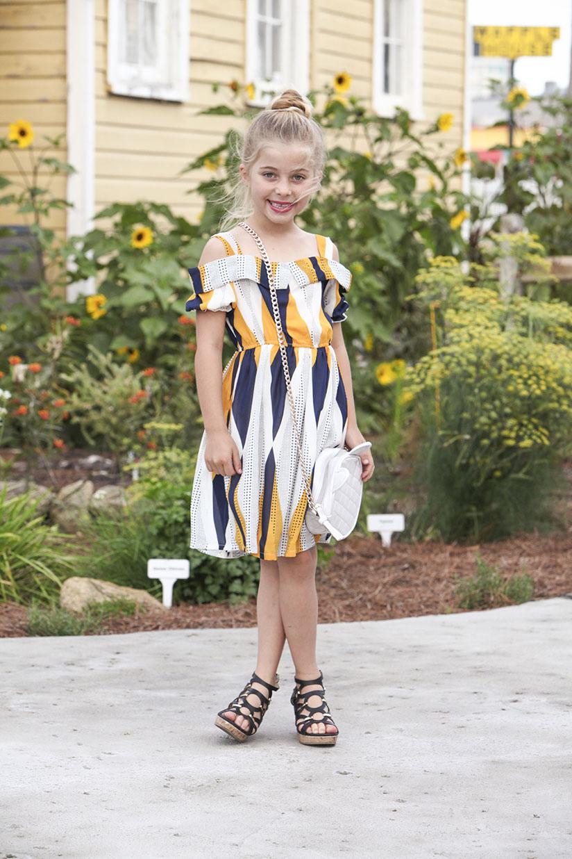 Little girl modeling dress