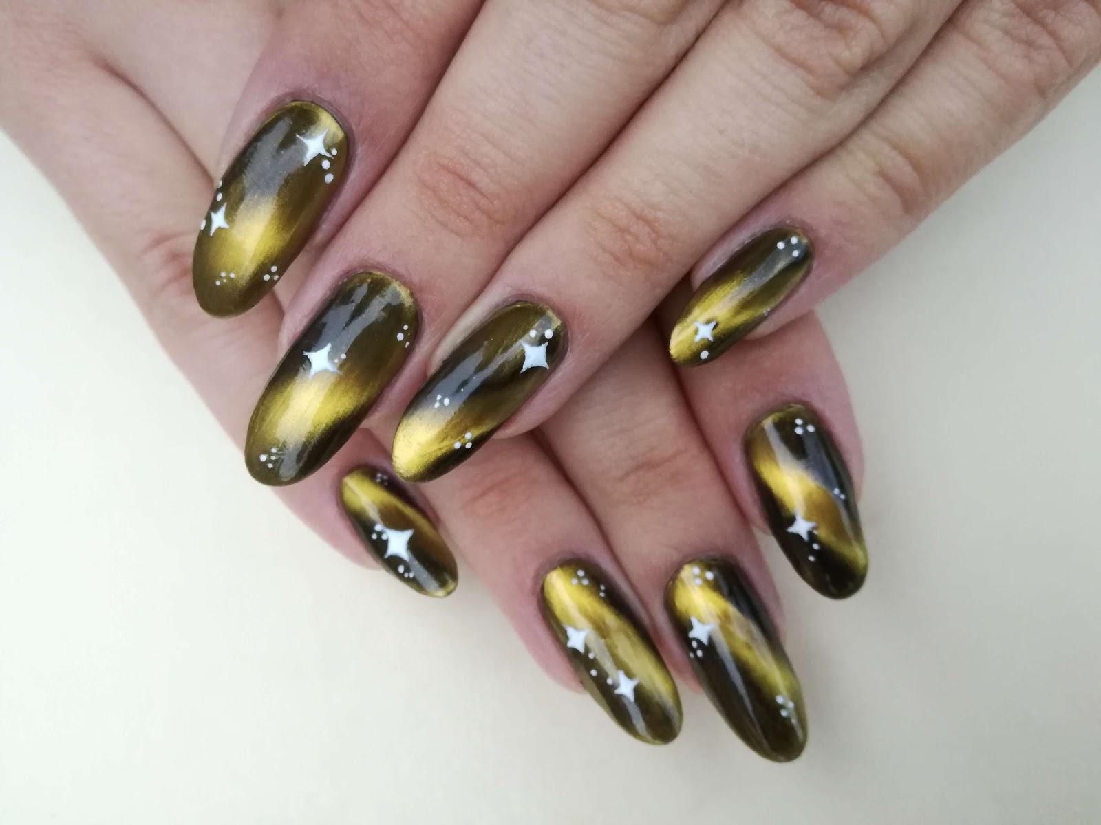 złote paznokcie kocie oko