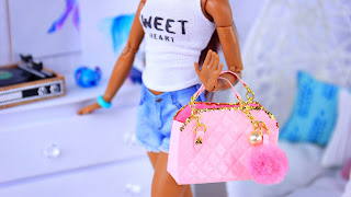 ... cute little purse will look great with any doll and any outfit