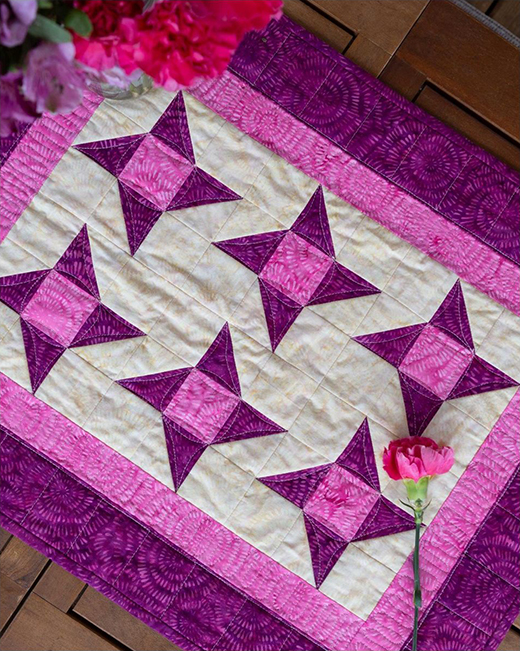 Friendship Star Table Topper Free Pattern designed by Accuquilt