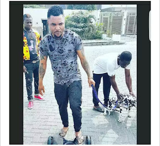Oritsefemi On A Hoverboard with his Cute Dalmatian Dog(Photo)
