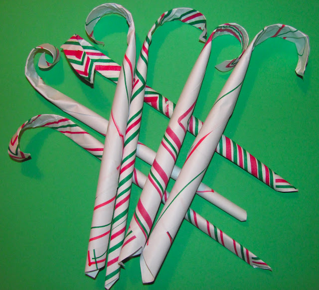 Watch this video to learn how to make a paper candy cane. After you braid the entire length of the ribbon, use hot glue to tack the ends off. Bend the top of the candy cane using your hands to make .